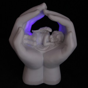 Hand med ängel